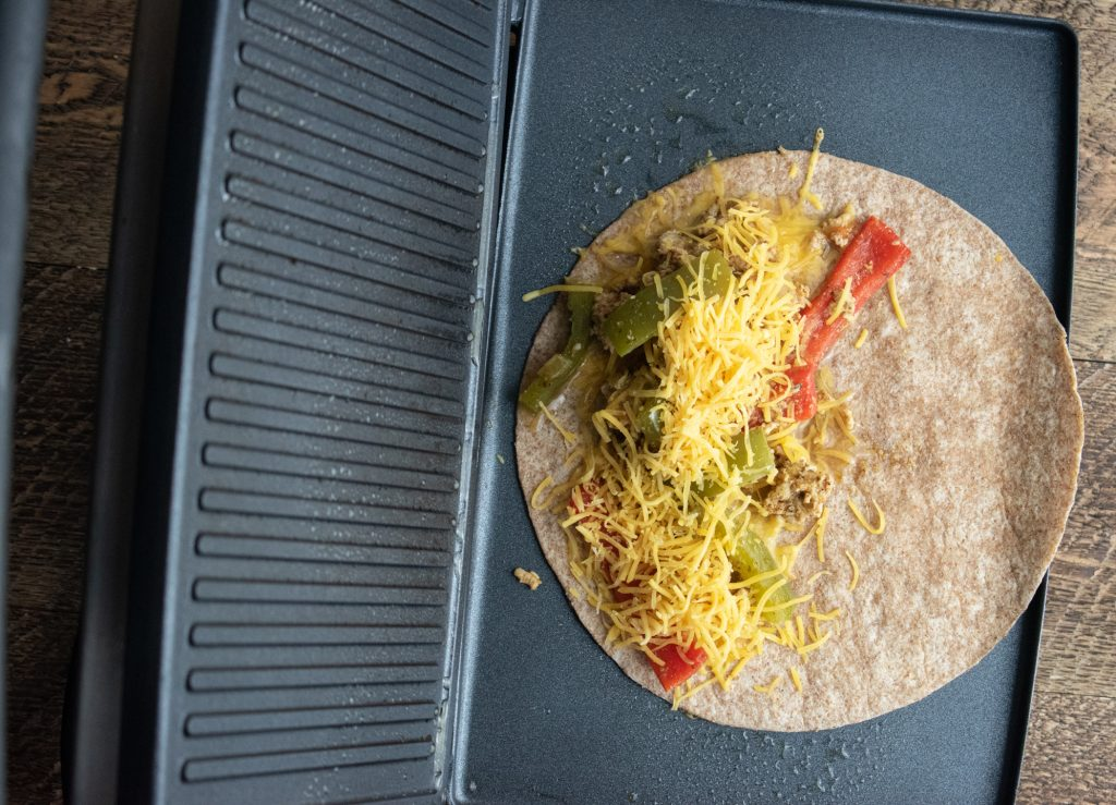 more cheese on top of your chicken and veggie mix to make healthy chicken quesadilla