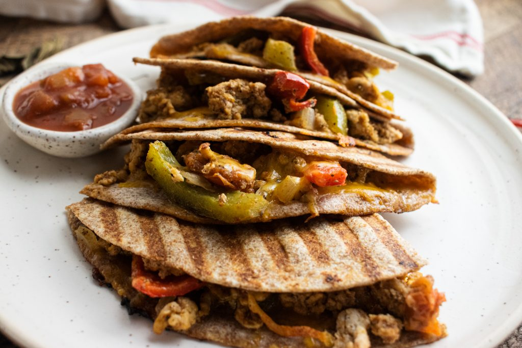 close up of healthy chicken quesadillas on a white plate
