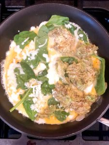 mashed avocado in an omelette with spinach and cheese