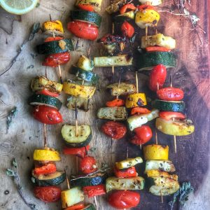 grilled veggie kabobs on a wooden board