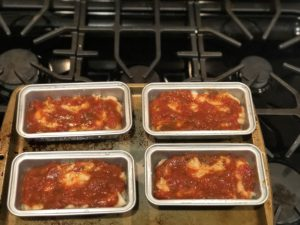 mini chicken parm meatloaf with sauce on top