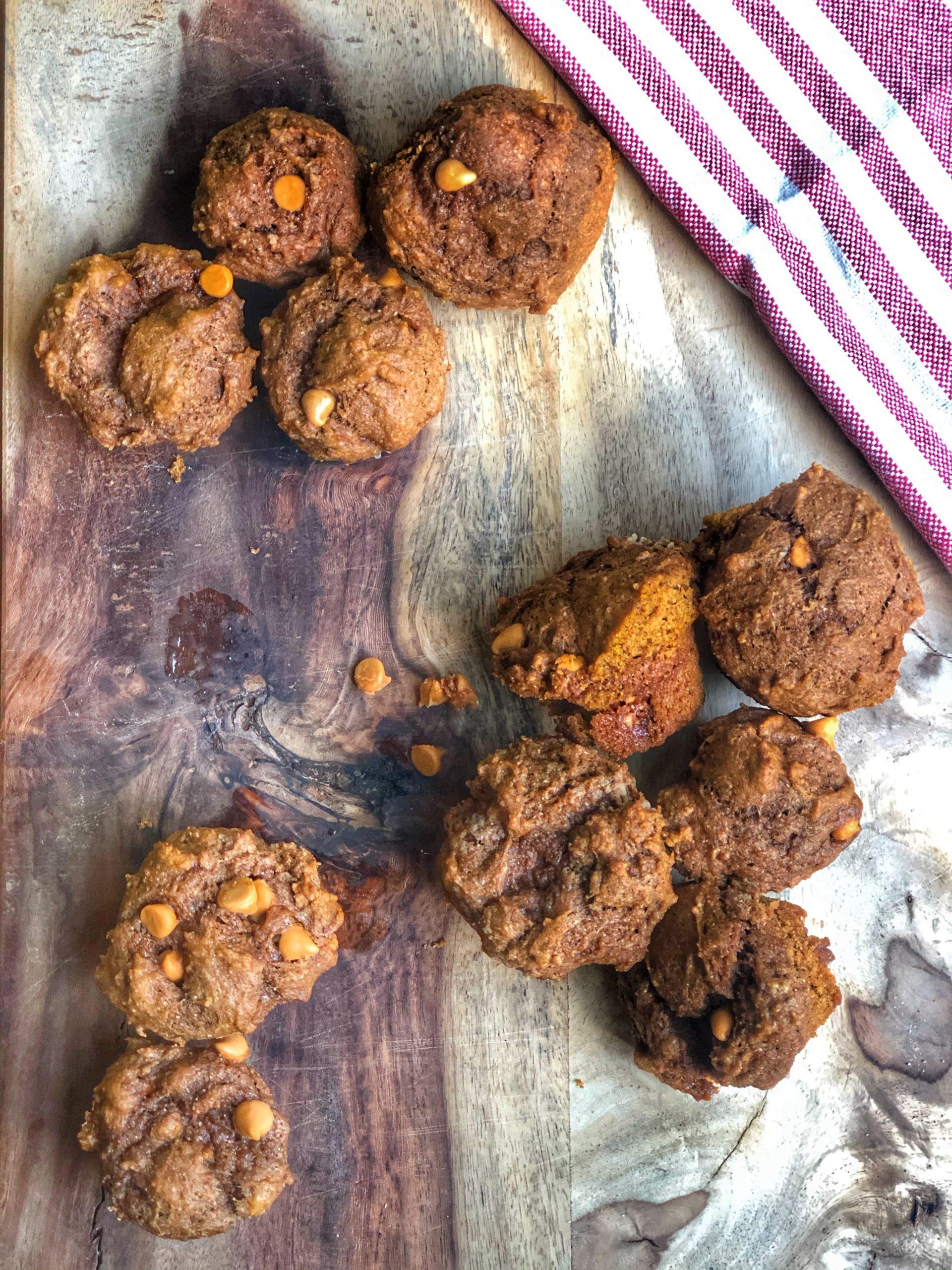 butterscotch pumpkin protein mini muffins on a wooden board