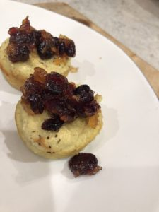 close up of the cranberry chutney sauce on top of the cauliflower latke muffins