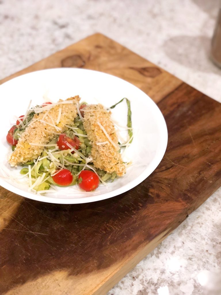 panko chicken over zoodles with cherry tomatoes