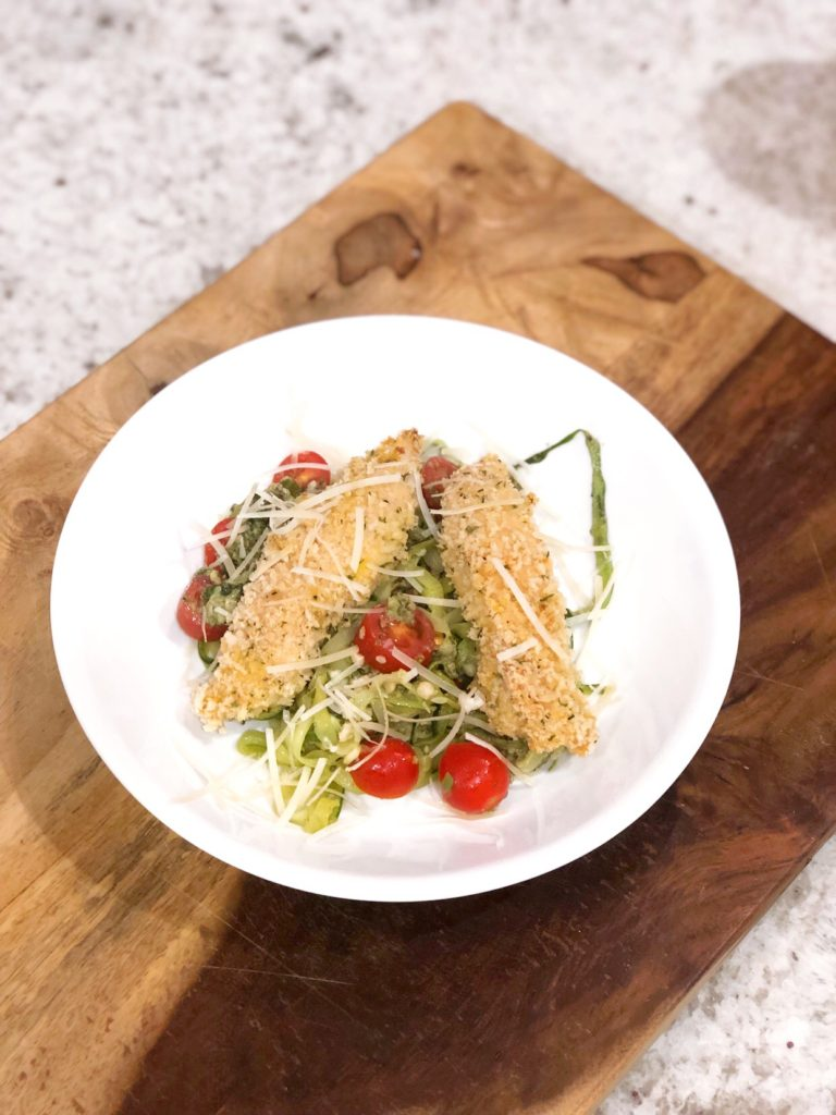 birds eye view of panko chicken over zoodles