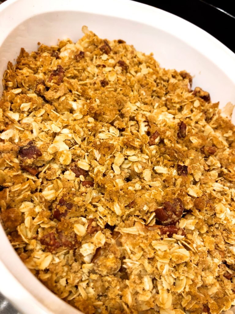 close up view of a fruit crisp in a white baking dish