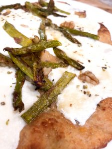 close up of naan asparagus pizza