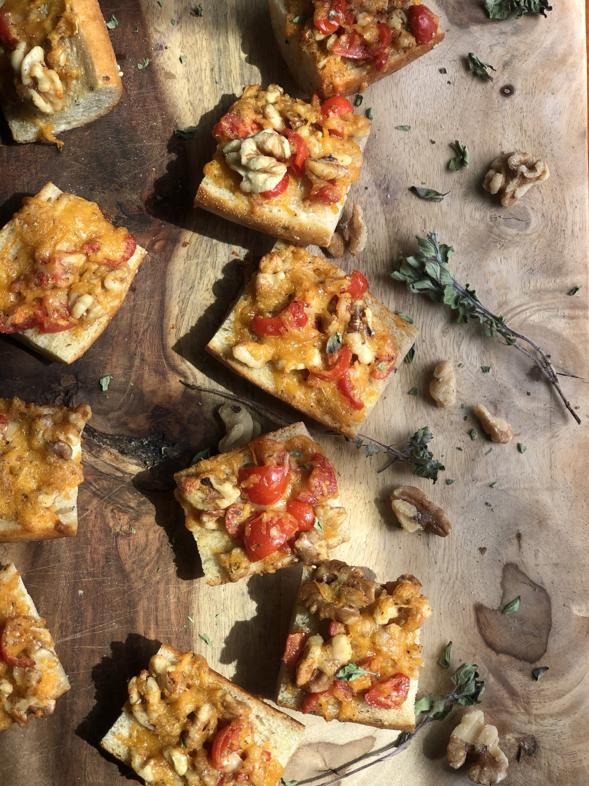 walnut cheese crostinis on a wooden board