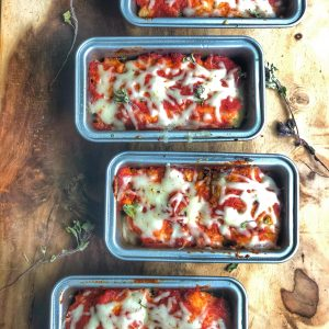 mini chicken parm meatloaves on a wooden board