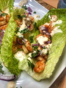 close up of honey adobo shrimp tacos