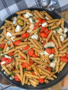 cherry tomato and garlic penne with mozzarella and zucchini in a large nonstick skillet