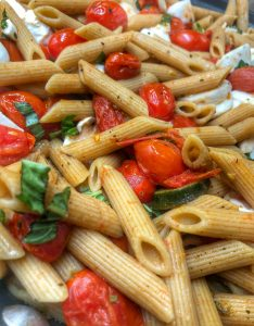 close up of cherry tomato and garlic penne