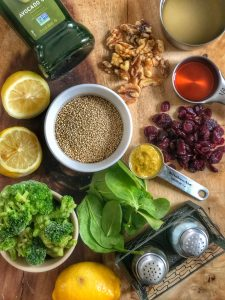 ingredients to make roasted lemon chicken with broccoli and quinoa