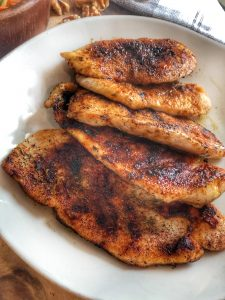 a plate of jerk chicken in a fanned out position